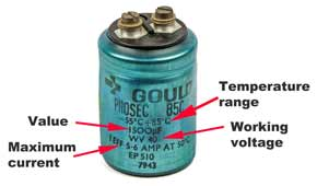 Leaded aluminium electrolytic capacitor showing the key parameters marked on the case including maximum ripple current.