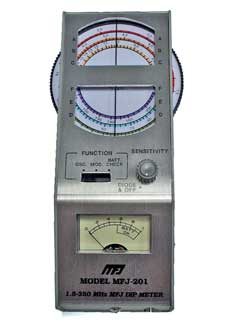 A typical analogue grid dip oscillator GDO / dip meter showng the main controls including the large tuning dial