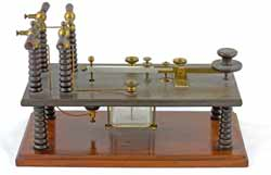 A Morse key used on spark gap transmitters showing the insulators used to withstand the high voltages.