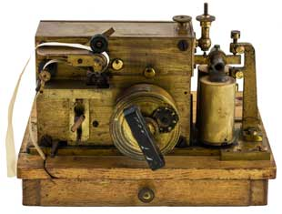An image of a Morse telegraph inker machine used for marking telegraph characters directly onto paper