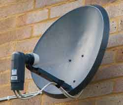 Domestic satellite television parabolic reflector antenna with an offset feed to reduce aperture block.