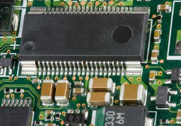 SMD capacitors and other SMT components on a printed circuit board