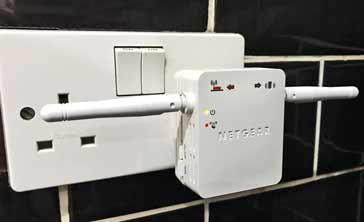 Typical Wi-Fi repeater used to extend the range of a Wi-Fi router in use